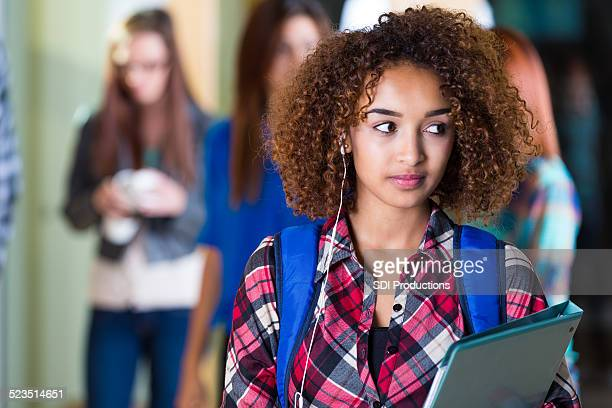 beautiful african american high school girl using phone outside classroom - beautiful ethiopian girls stock photos and pictures