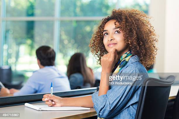 Beautiful African American student thinking during test