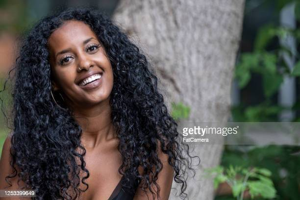 beautiful african american woman in her mid-20s - natural black hair stock pictures, royalty-free photos & images