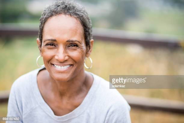 beautiful african american woman senior portrait - 60 years old woman stock photos and pictures