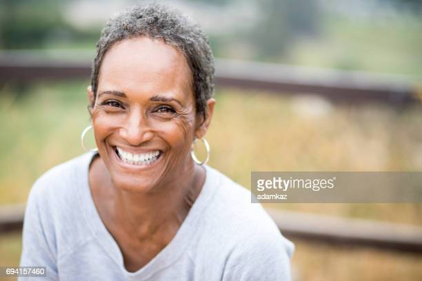 beautiful african american woman senior portrait - 60 64 years stock pictures, royalty-free photos & images