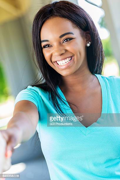 Beautiful African American Woman smiling and shaking hands