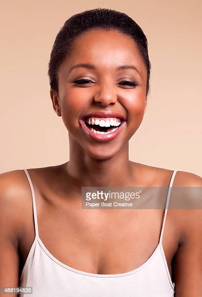 beautiful african woman laughing and smiling - light skin black woman stock photos and pictures
