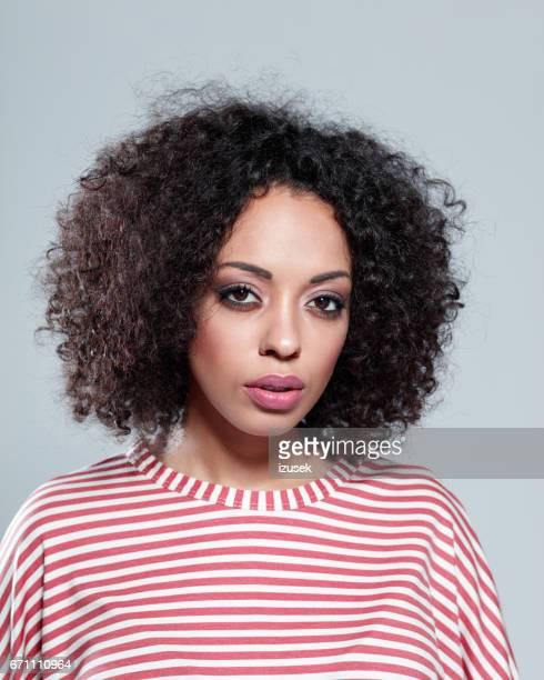 Beautiful african woman staring at camera