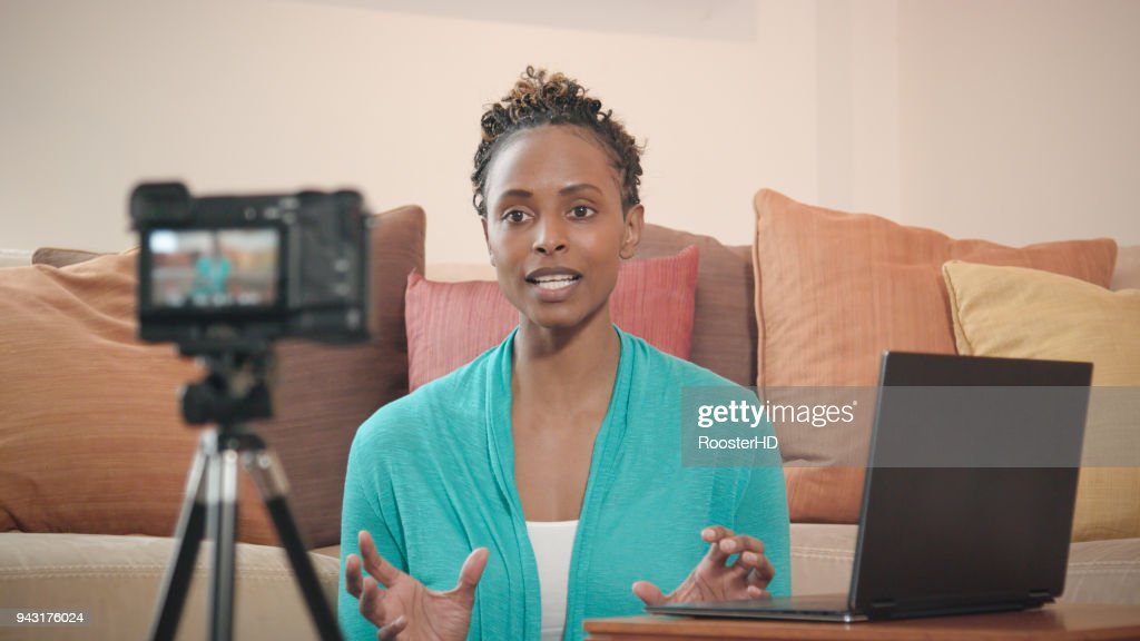 Beautiful African-American Vlogger Recording Livestream for her Show : Stock Photo