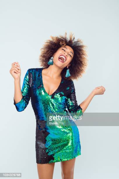 beautiful afro american young dancing in sequined dress - green dress stock pictures, royalty-free photos & images