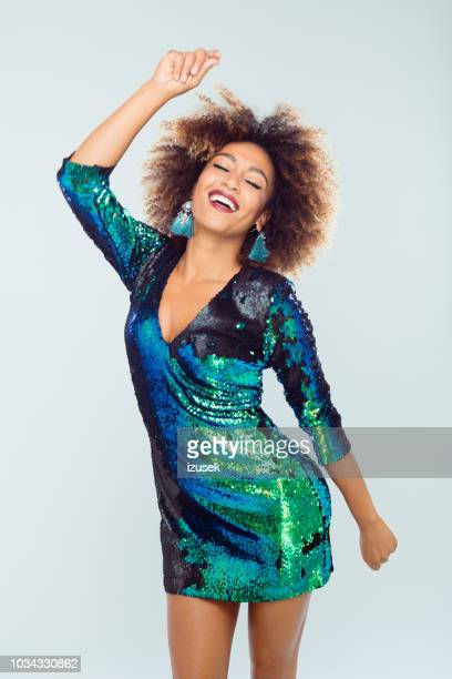 beautiful afro american young dancing in sequined dress - sequin dress stock pictures, royalty-free photos & images