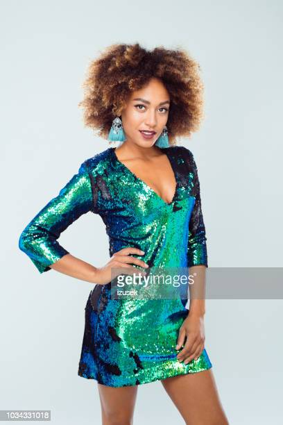 beautiful afro american young in sequined dress - green dress stock pictures, royalty-free photos & images
