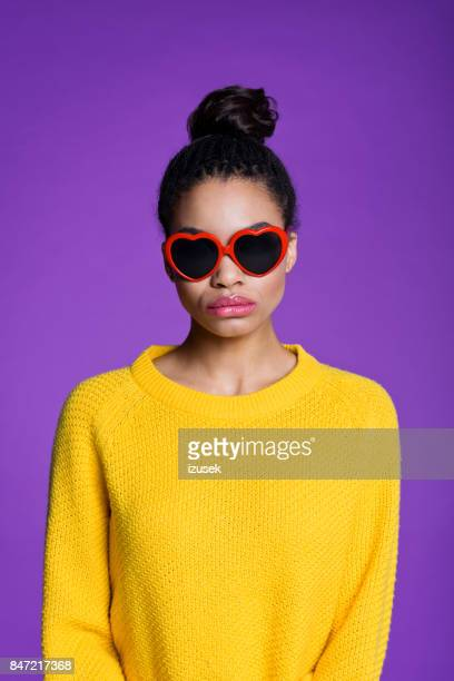beautiful afro american young woman in heart shaped sunglasses - izusek stock pictures, royalty-free photos & images