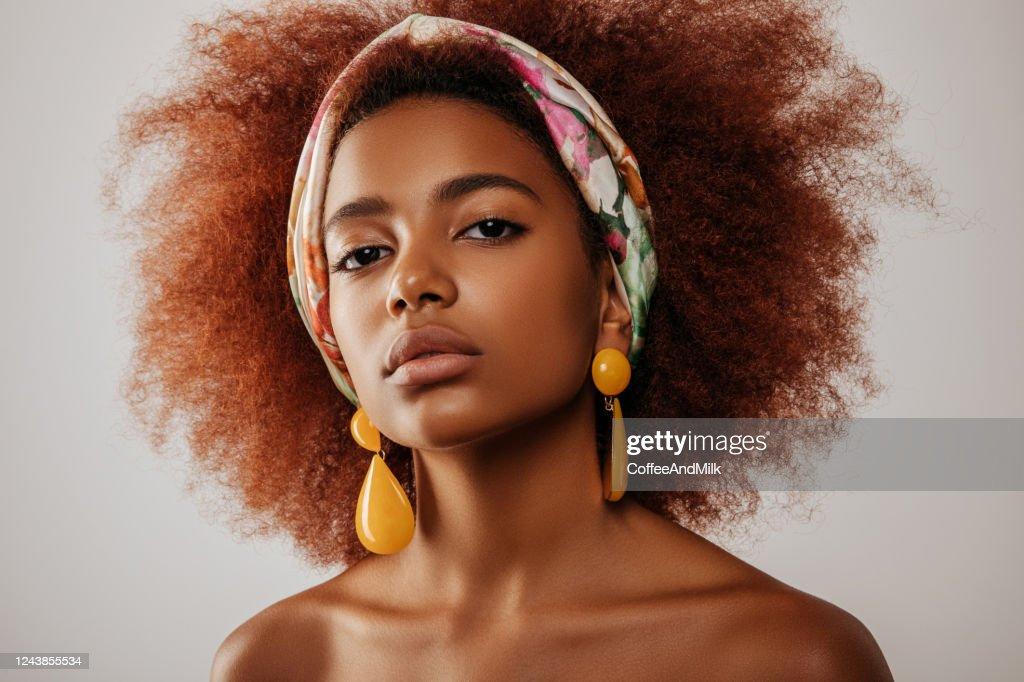 Beautiful afro girl with earrings : Stock Photo