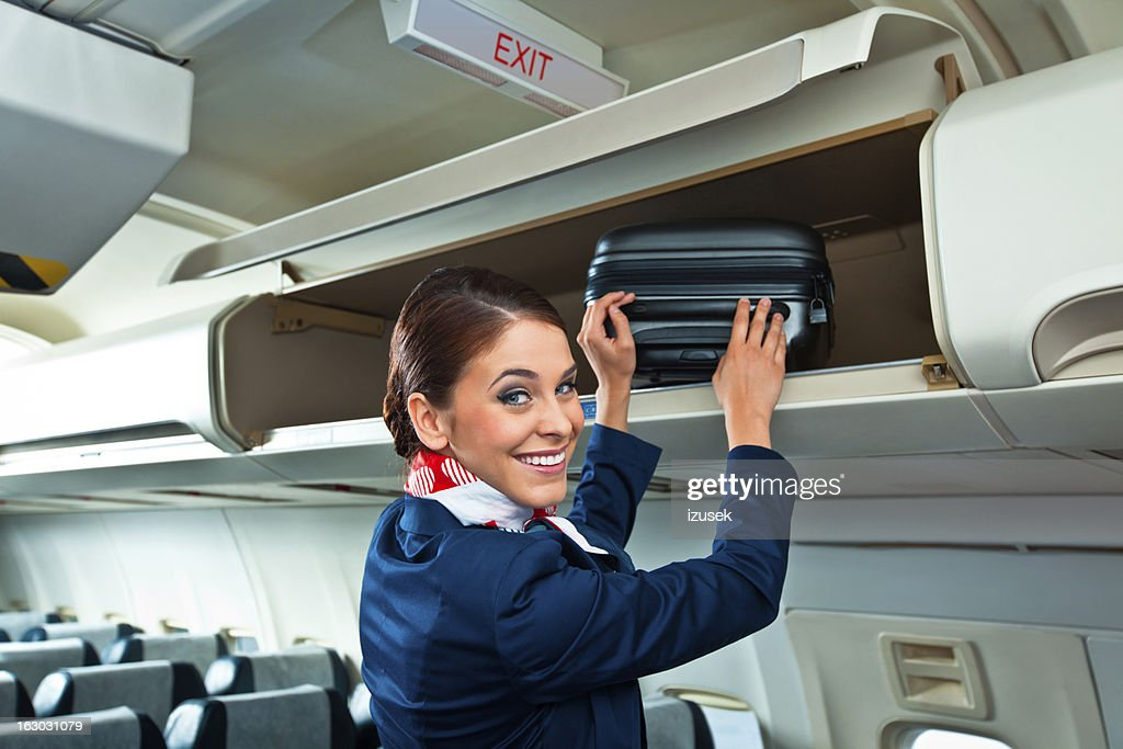 Beautiful air stewardess : Stock Photo