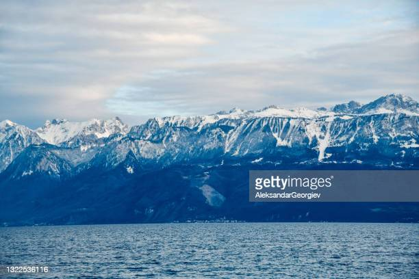 beautiful alps near lake léman in lausanne, switzerland - vaud canton stock pictures, royalty-free photos & images