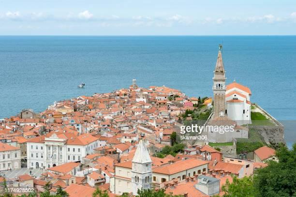 beautiful ancient piran city near adreatic sea with cloudy day slovenia - スロベニア国旗 ストックフォトと画像