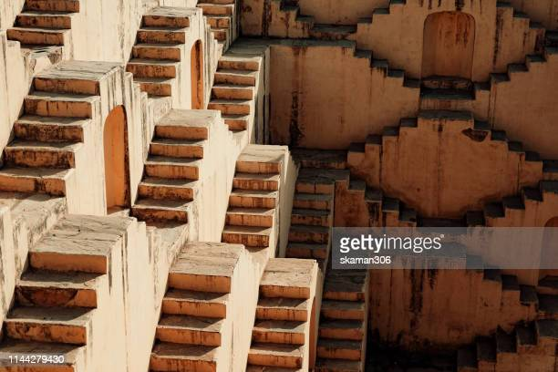 beautiful ancient stepwell panna meena ka kund near amber fort jaipur india - stepwell stock photos and pictures