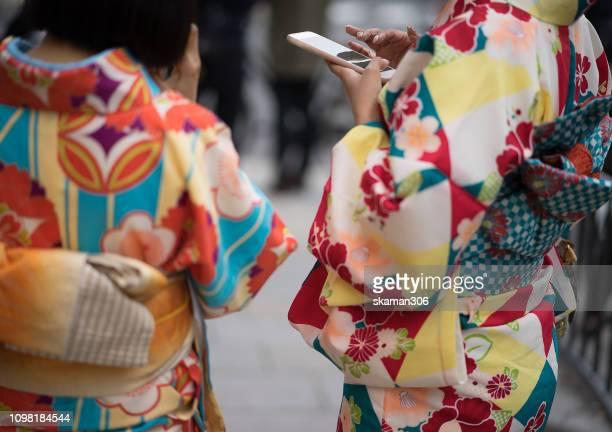 beautiful and colourful japanese traditional dress kimono at kyoto japan - 帯 ストックフォトと画像