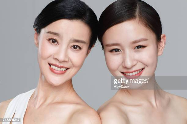 Beautiful and elegant mother and daughter