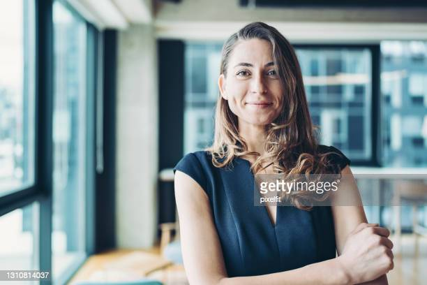 beautiful and elegant young businesswoman - mid adult stock pictures, royalty-free photos & images