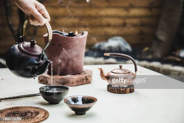 beautiful and exquisite chinese tea ceremony- boiling the water for making tea in a traditional charcoal stove - cultures stock pictures, royalty-free photos & images