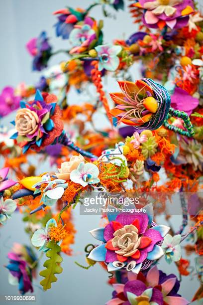 a beautiful and vibrant display/arrangement of flowers and multimedia - multimedia stock pictures, royalty-free photos & images