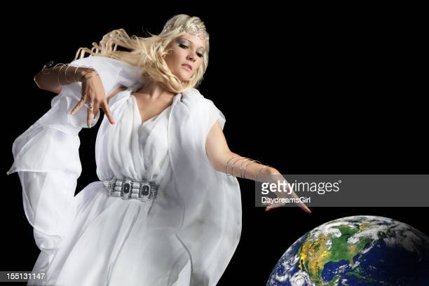 Beautiful Angel Flying and Pointing at Earth