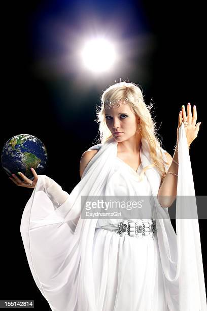 beautiful angel holding earth - earth angel stock pictures, royalty-free photos & images