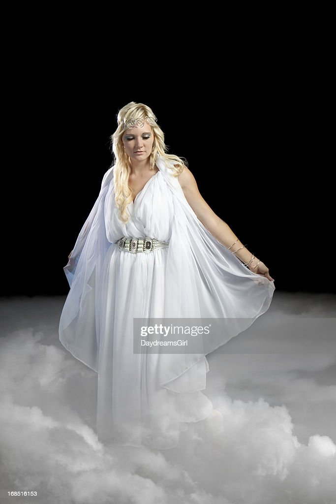 Beautiful Angel Walking on Clouds : Stock Photo