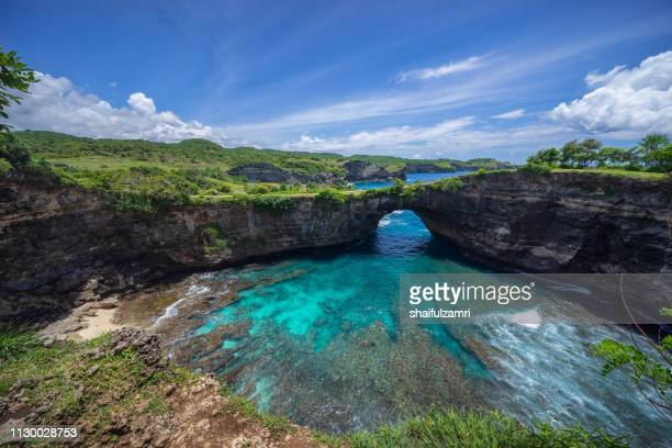 Beautiful arched broken beach with big waves and crystal clear water in Nusa Penida in Bali, Indonesia.