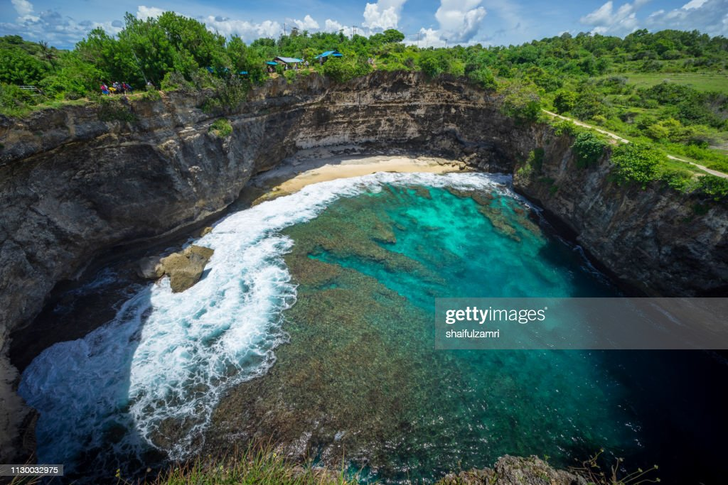 Beautiful arched broken beach with big waves and crystal clear water in Nusa Penida in Bali, Indonesia. : Stock Photo