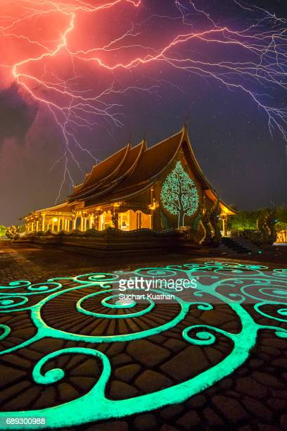 a beautiful art in the thai temple at night and the sky lightning - phosphorescence stock pictures, royalty-free photos & images