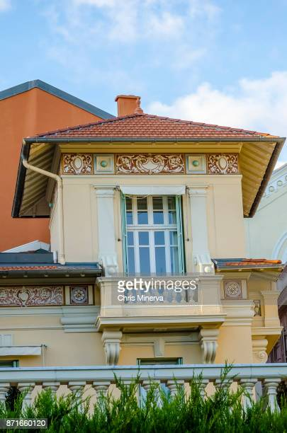beautiful artwork on upper balcony of residence house in monte carlo - monte carlo stock pictures, royalty-free photos & images