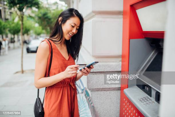 beautiful asian banking and shopping in the city - bank account stock pictures, royalty-free photos & images
