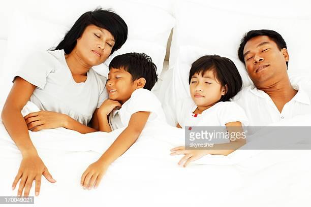 Beautiful Asian family sleeping.