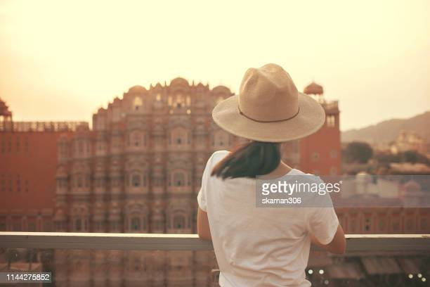 beautiful asian female sightseeing and sunset over hawa mahal at pink city jaipur rajasthan india - amber fort stock pictures, royalty-free photos & images