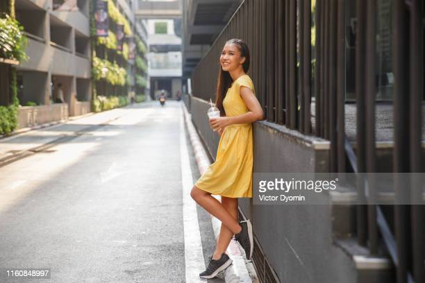 beautiful asian girl in a yellow dress - yellow dress stock pictures, royalty-free photos & images