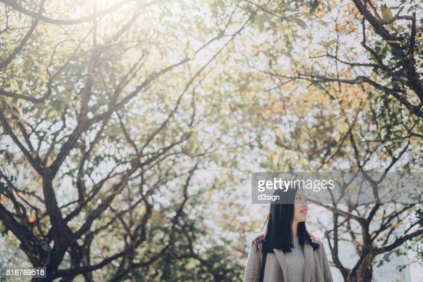 beautiful asian girl relaxing and enjoying the natural scenics in park - holy city park stock pictures, royalty-free photos & images