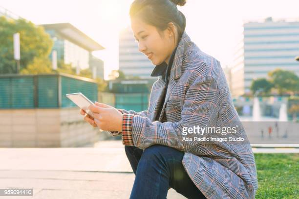 beautiful asian girl with digital tablet in modern city,shanghai,china - studio city stock pictures, royalty-free photos & images