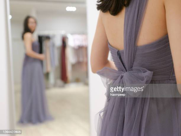 beautiful asian lady trying on evening dress, bridesmaid dress fitting session - long dress stock pictures, royalty-free photos & images