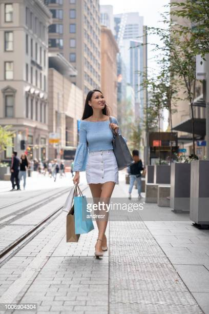beautiful asian shopping woman outdoors - mongolian women stock photos and pictures