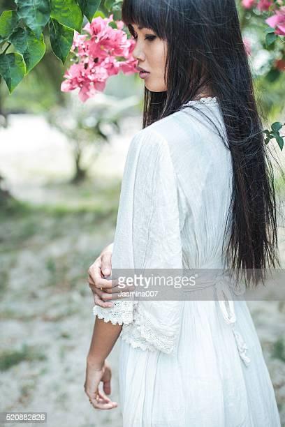 Beautiful asian woman in long white dress