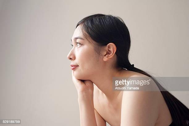 Beautiful asian woman looking up