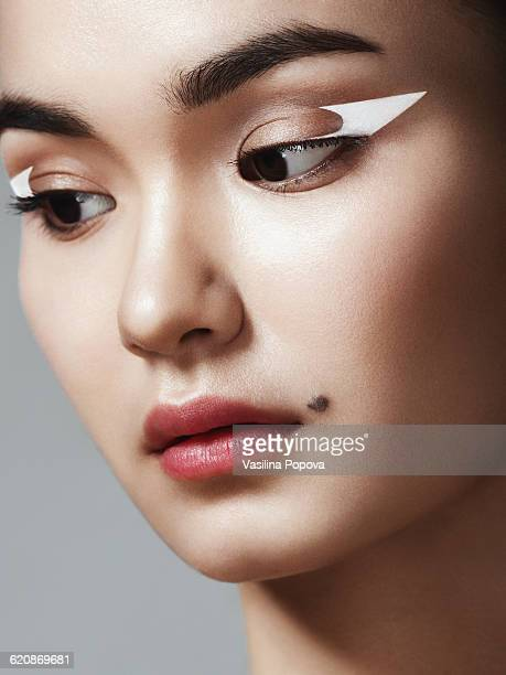beautiful asian woman - mole stock photos and pictures