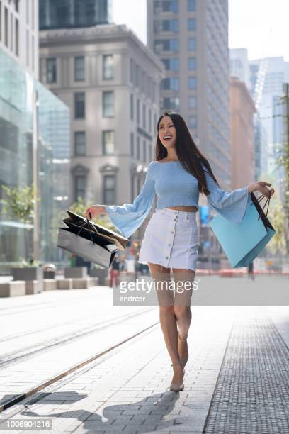 beautiful asian woman shopping - mongolian models stock pictures, royalty-free photos & images