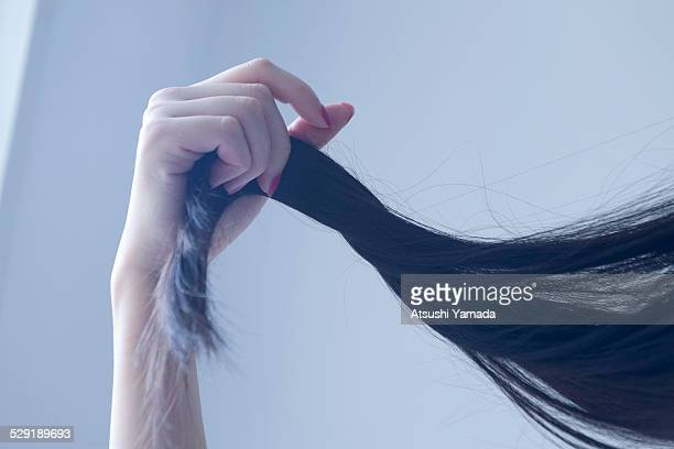 beautiful asian woman touching her hair - 黒髪 ストックフォトと画像