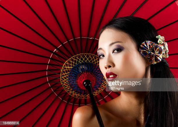 Beautiful asian woman with a red umbrella