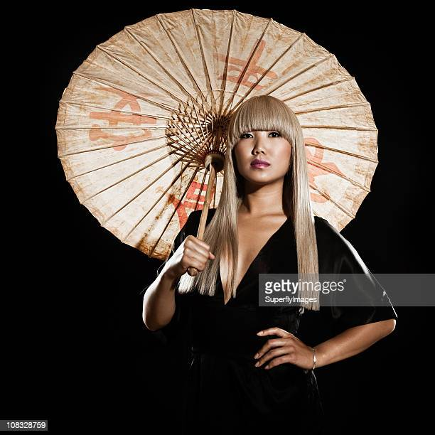 Beautiful Asian Woman with Long Blonde Hair Holding a Parasol
