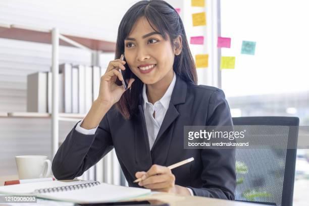 beautiful asian woman working in office. - タイ人 ストックフォトと画像