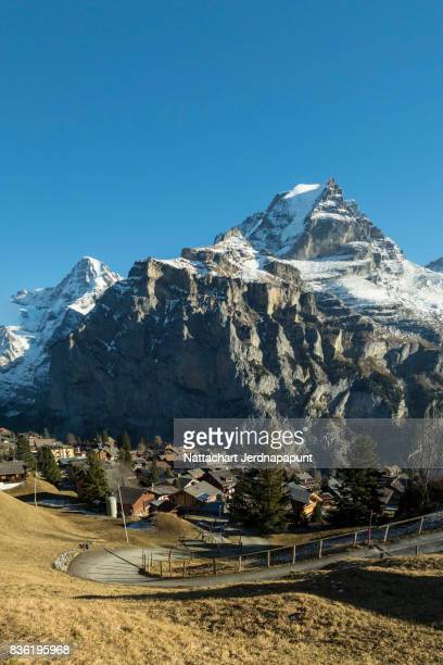 Beautiful atmosphere of Murren village covered with snowcapped Jungfraujoch mountain range