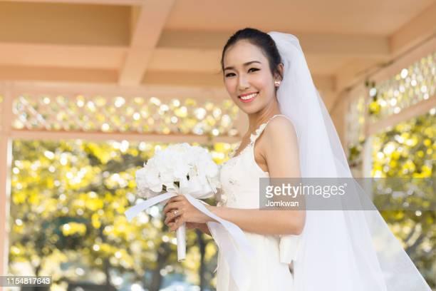 beautiful attractive asian bride woman wearing