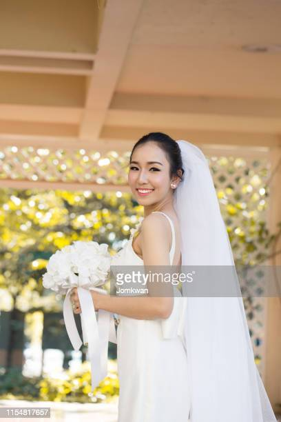beautiful attractive asian bride woman wearing