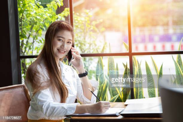 beautiful attractive asian business woman writing